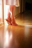 Female legs standing on toes on hardwood floor poster