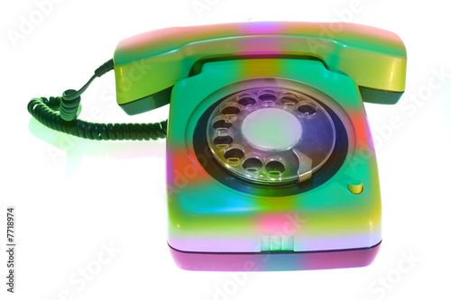 Old colorful telephone on white background