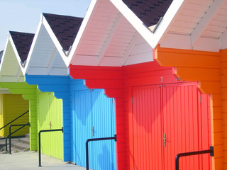 Colorful beach chalets by seaside