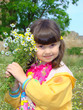 Pretty girl of preschool age with the bouquet of camomiles.
