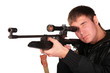 young man to aim from sniper gun