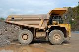 Big dumper truck in a stone pit poster