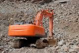 Red excavator in a stone pit poster
