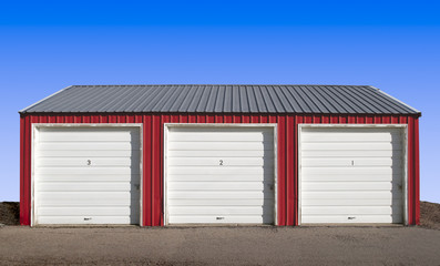 Three Storage Locker Doors with a Blue Sky Background