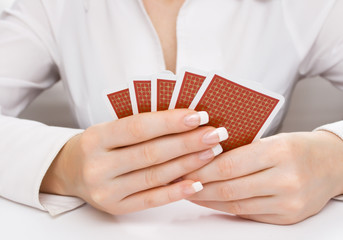 Woman's hands holding playing cards