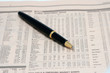 an expensive pen on a newspaper
