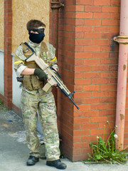 Man with Gun and Face Mask