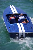 Blue Motor Boat With White Stripes poster