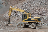 Excavator in a stone pit poster