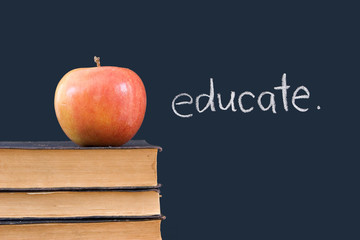 educate on chalkboard with apple & books
