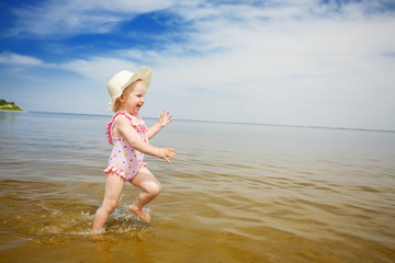 blue sky, water and running child