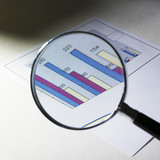 Magnifying glass and statistic poster