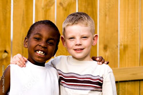 Leinwanddruck Bild two friends playing outside