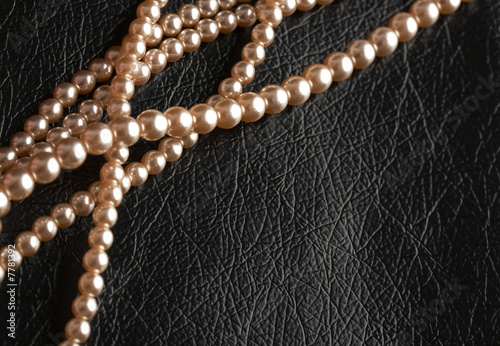 pearls on black leather