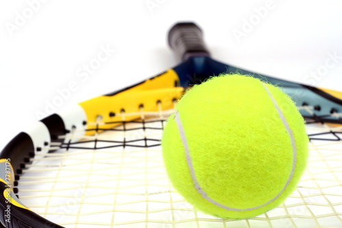 Close up of a tennis ball and racket isolated