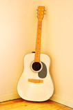 Very old Acoustic Guitar with worn strings. poster