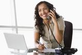 Fototapety Businesswoman taking telephone call