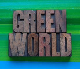 the words 'green world' in letterpress wood type