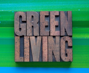 the words 'green living' in letterpress wood type