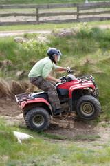 men riding on a quad