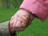 grandson and grandmother holding hands poster