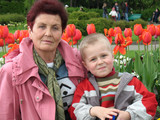 grandson and grandmother in garden poster
