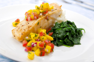 Sea bass with mango salsa,  mashed potato and spinach