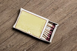 Matchbox on old table.