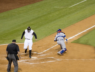 Baseball player scoring a run