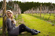 Beautiful young woman at the vineyard