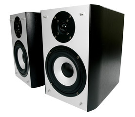 Two silver and black speakers against a white background
