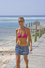 Beautiful Woman walking on a Cayman Island Dock