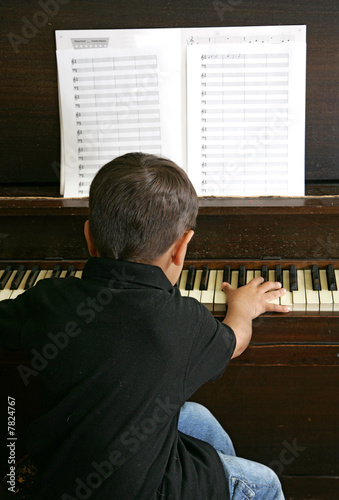 young boy playing piano