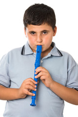 boy playing recorder