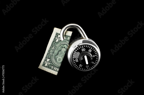 Dollar Bill Locked Up Against Black