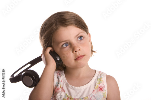 Shot of a young blonde girl listening to music