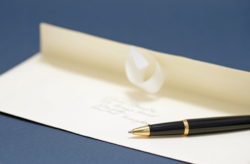 a letter and a pen