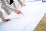 Fototapety Architects planning on blueprint