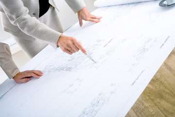 Architects planning on blueprint
