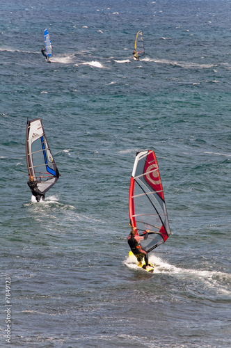 Windsurfers sufing on the sea of beach Pozo Izquierdo. Gran Cana