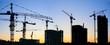 Leinwanddruck Bild - construction cranes silhouette sunset