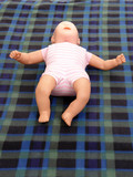 Infant first aid training dummy poster