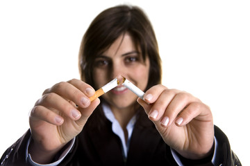 young woman breaking cigar - anti-tobaco concept