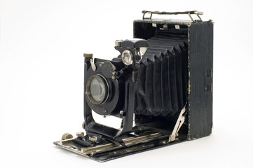 Old classical camera with furs.