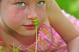 Young Girl Smelling Wildflower poster