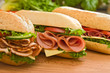 Leinwanddruck Bild - Ham sandwich, turkey sandwich and salami sandwich
