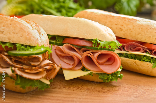 Fotobehang Snack Ham sandwich, turkey sandwich and salami sandwich