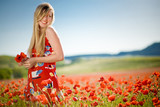Laughing woman in poppy field poster