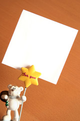 Bear memo holder and white card with copy space