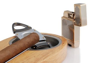 close up of ashtray, lighter and cuban cigar